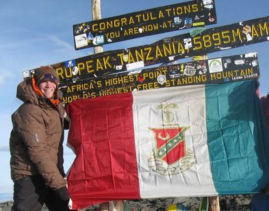 Carrying your frats flag to the top of Mt. Kilimanjaro. TFM.
