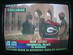 Marines flying the UGA flag on Fox News at Saddam's palace. USA. SEC. TFM.