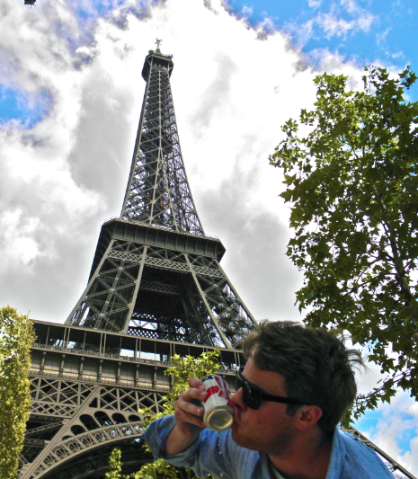 Shotgunning an American flag Budweiser at the base of the Eiffel Tower. TFM.