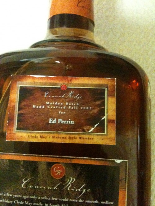 """Father having personalized bottles of the maiden batch of the now illegal """"Official Alabama State Spirit."""""""