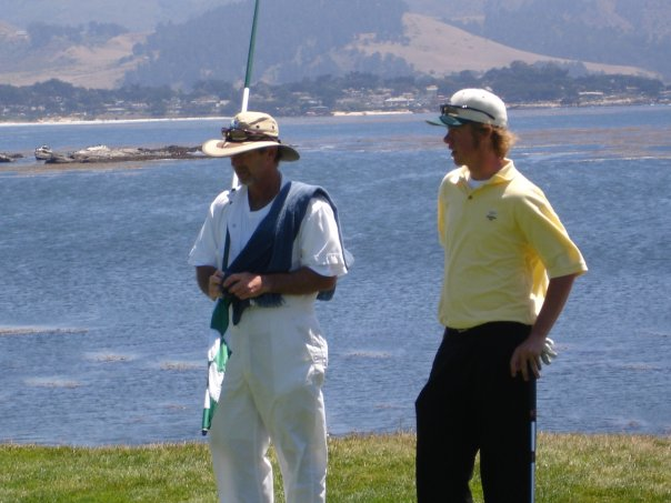 Talking with my caddy on 18 at Pebble.