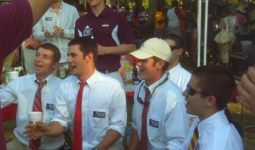 Pledges singing the slam of the week happy birthday at a tail gate.