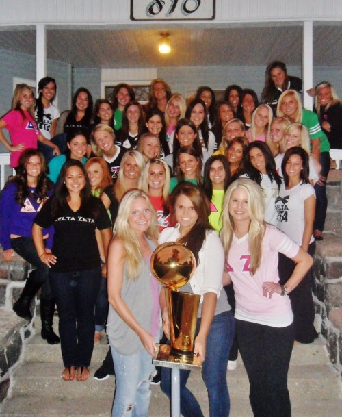 Posing for pictures with the NBA championship trophy...no big deal.