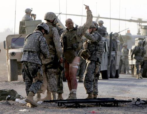 Gunnery Sergeant Iron Mike Burghardt of the United States Marine Corps rendering a one-fingered salute to the insurgent who tried to blow him up. TFM.