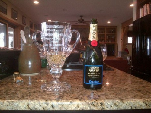 Drinking champagne out of the To Honor and Serve trophy. TFM.