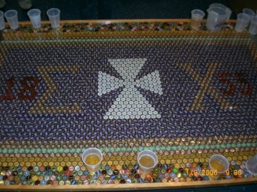 Saw some half-ass beerpong table on here, decided to show you how our chapter gets down...6,000 beer caps.