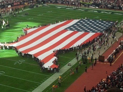 Celebrating America from the club level of the Texans first playoff game. TFM.