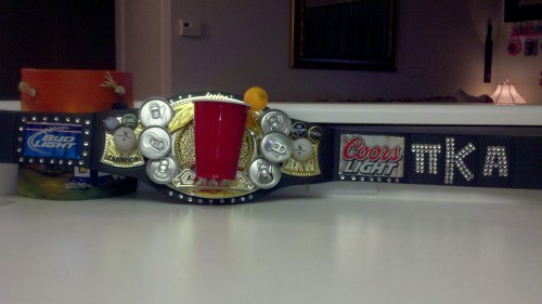 Beer pong champion belt with spinning cup.