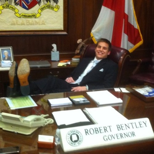 Kicking your feet up at the Governor's desk.
