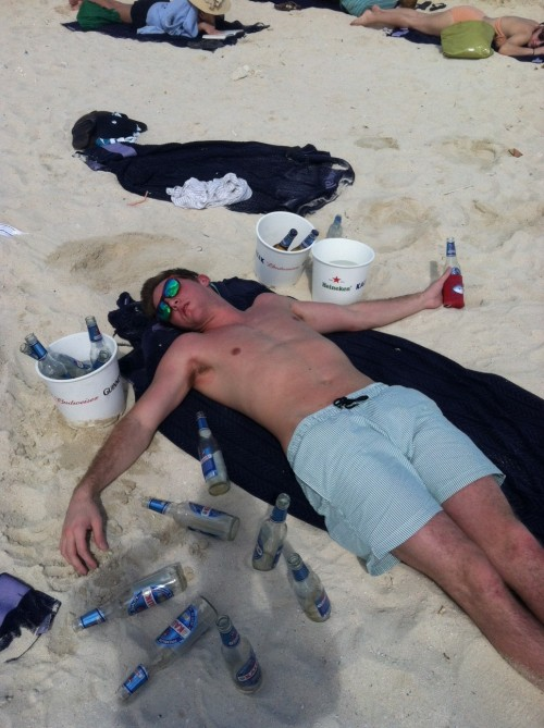 Passed out by 11AM, koozie still keepin' that beer cold. TFM.