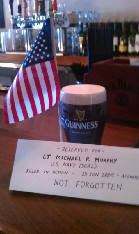 Leaving a beer for fallen SEAL Lt. Michael P. Murphy. TFM.