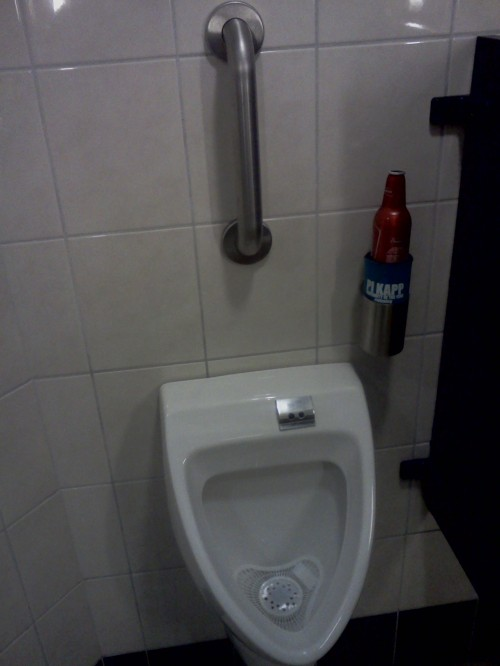 Why doesn't every urinal come equipped with a handle and a place for your beer? TFM.