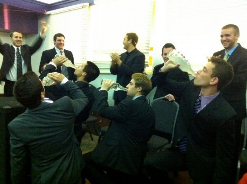 Hazing the new council at their induction. TFM.
