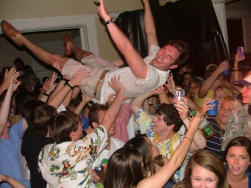 Crowd surfing during a rock concert in the chapter room. TFM.