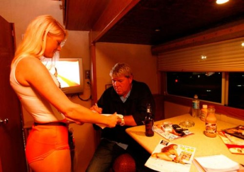 John Daly's trailer at Augusta being filled with beer, cigs, porno mags, and Hooters waitresses. TFTC.