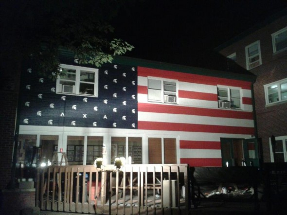 Red, White, and Blue over the Lambda Chi porch. TFM.