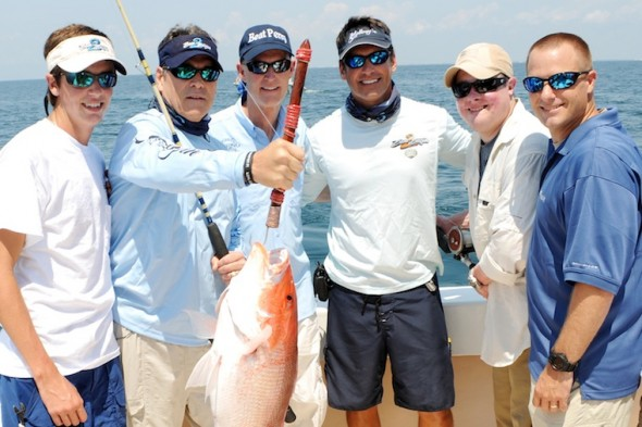 Gov. Perry and Gov. Scott fishing with veterans. TFM.