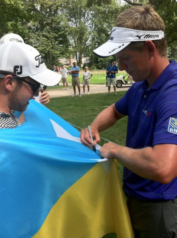 Brother Luke Donald signing the flag at the BMW Championship. TFM.