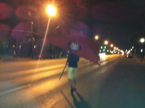 Borrowing an umbrella for the walk home from the bar. TFM.