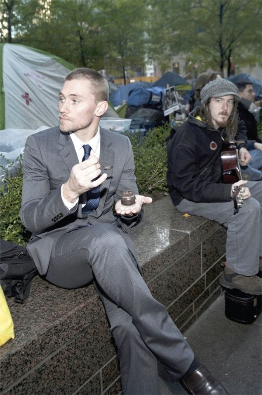 Wearing a suit and eating caviar in the middle of Occupy Wall Street. TFM.
