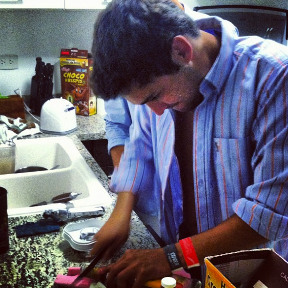 Cutting the security cap off the tequila bottle. TFM.
