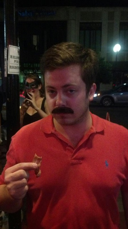 Ron Swanson eating bacon at the bars. TFM.