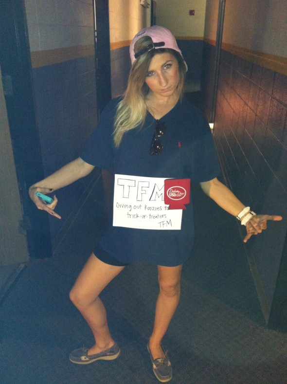 Giving out koozies to trick-or-treaters. TFM.