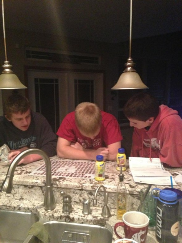 10th grade brother and his friends studying up on sister's sorority composite. TFM.