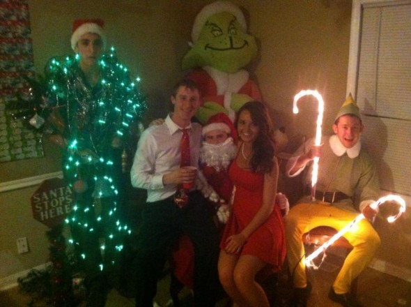 Date dash pictures with pledges posing as Santa, his elf and the Christmas. TFM.