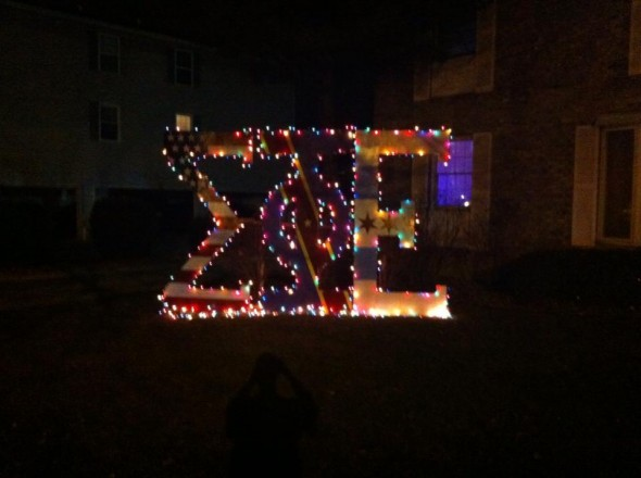 Decking the lawn letters out in Christmas lights. TFM.
