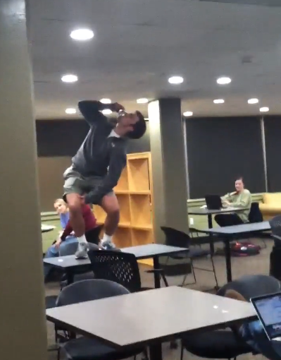 Shotgunning on a desk in the study lounge. TFM.