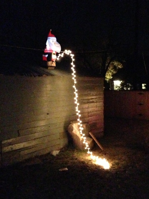 Santa pissing off the roof. TFM.