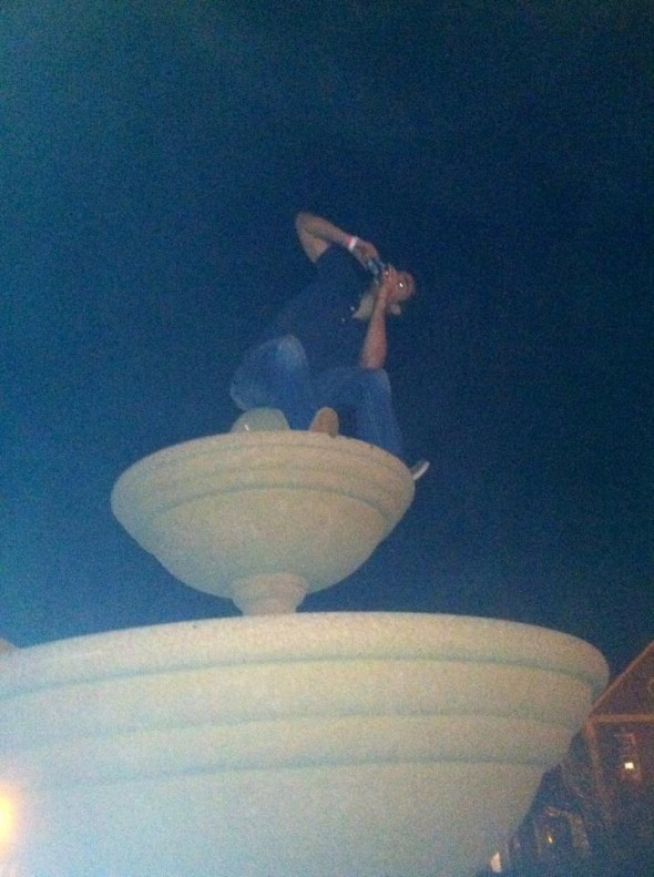 Shotguning a beer on top of the Phi Mu Fountain at Ole Miss. TFM.