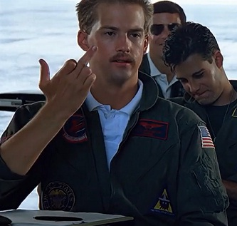 Goose only giving one fuck and still wearing a polo underneath his flight suit. TFM.