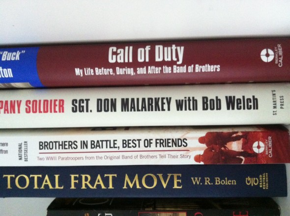 It's nestled next to three books, all of which are autographed by original Band of Brothers. TFM.