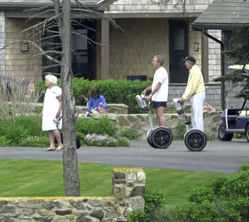 Presidents on Segways next to golf carts. TFM.