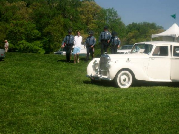 Getting arrested in boat shoes by four state troupers near a Rolls-Royce at Winterthur's Point to Point horse race. TFM.