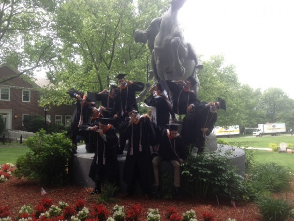 Shotgunning on the campus statue for graduation. TFM.