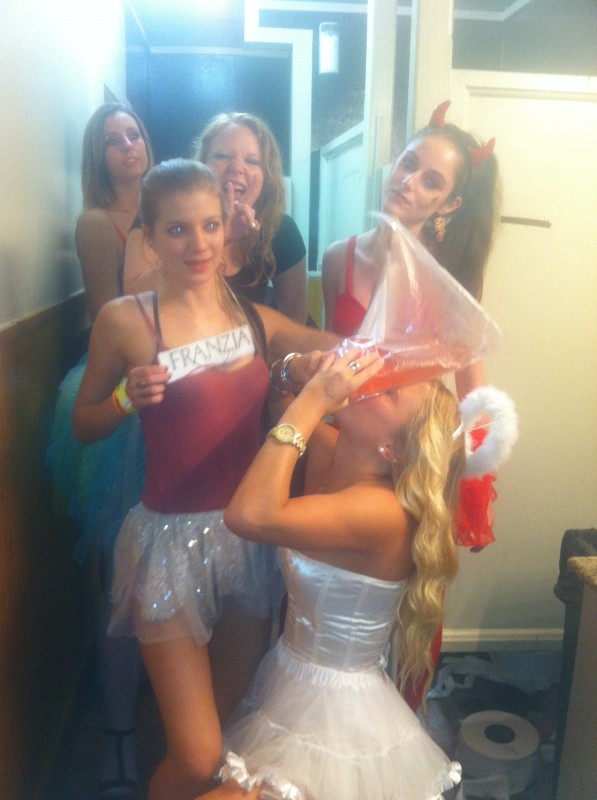 Franzia Fairy helping the needy in the bathroom of Reggies at LSU.