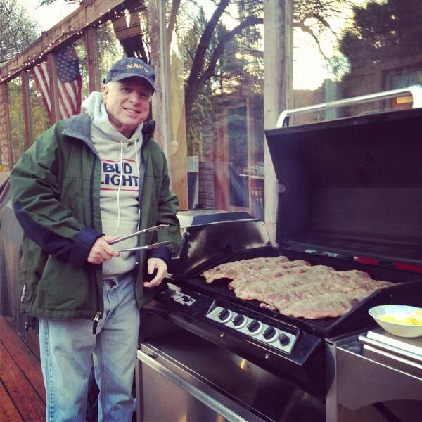 Senator John McCain grilling ribs in his dad jeans and bud light hoodie. TFM.
