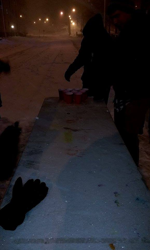 Playing beer pong in the middle of the street during a blizzard. TFM.