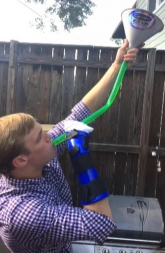 Not letting a broken arm get in the way of a beer bong. TFM.