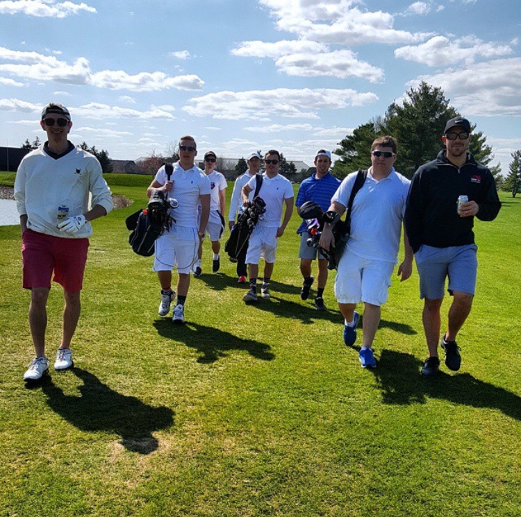 Enjoying a beer while the pledge caddies do the work. TFM.