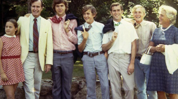 W. smoking a cig during the family photo. TFM.
