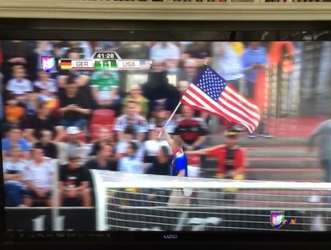 Waving Ol' Glory proudly in front of German fans. TFM.