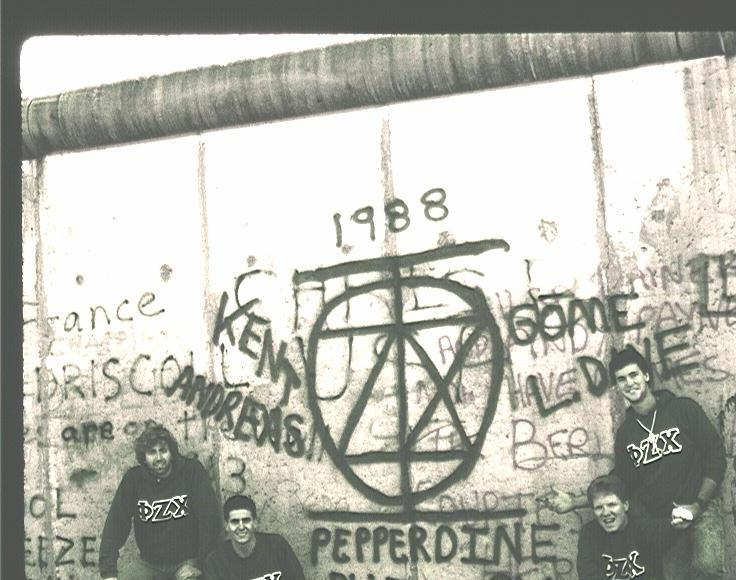 My old man and his crew spray painting their Phi Chi letters on the Berlin wall before it was torn down. TFM.
