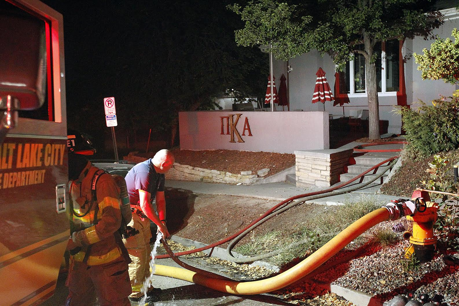 Fire crews respond to a call at the Pi Kappa Alpha fraternity house at the University of Utah, Friday, July 3, 2015. Fires were reported at two fraternity houses early morning Friday.