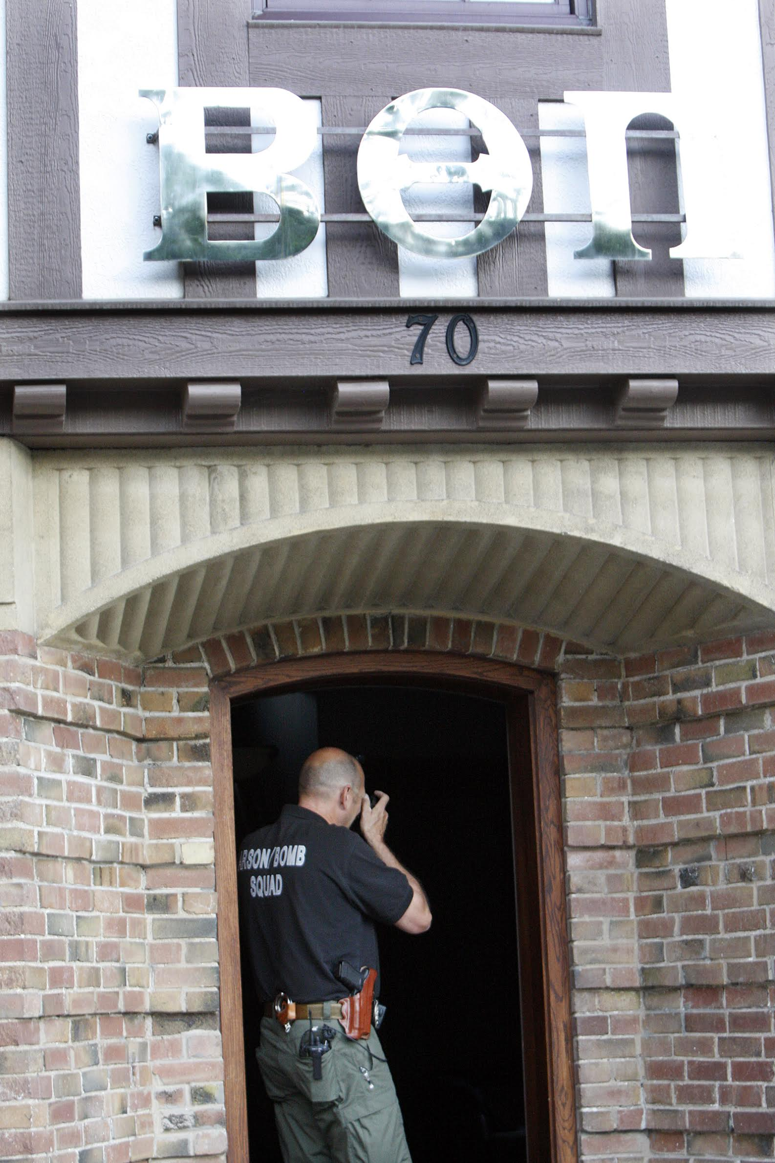 An SLCFD arson investigator takes photos inside the Beta Theta Pi house at the University of Utah, Friday, July 3, 2015. Two fraternity houses were damaged in fires early Friday morning.