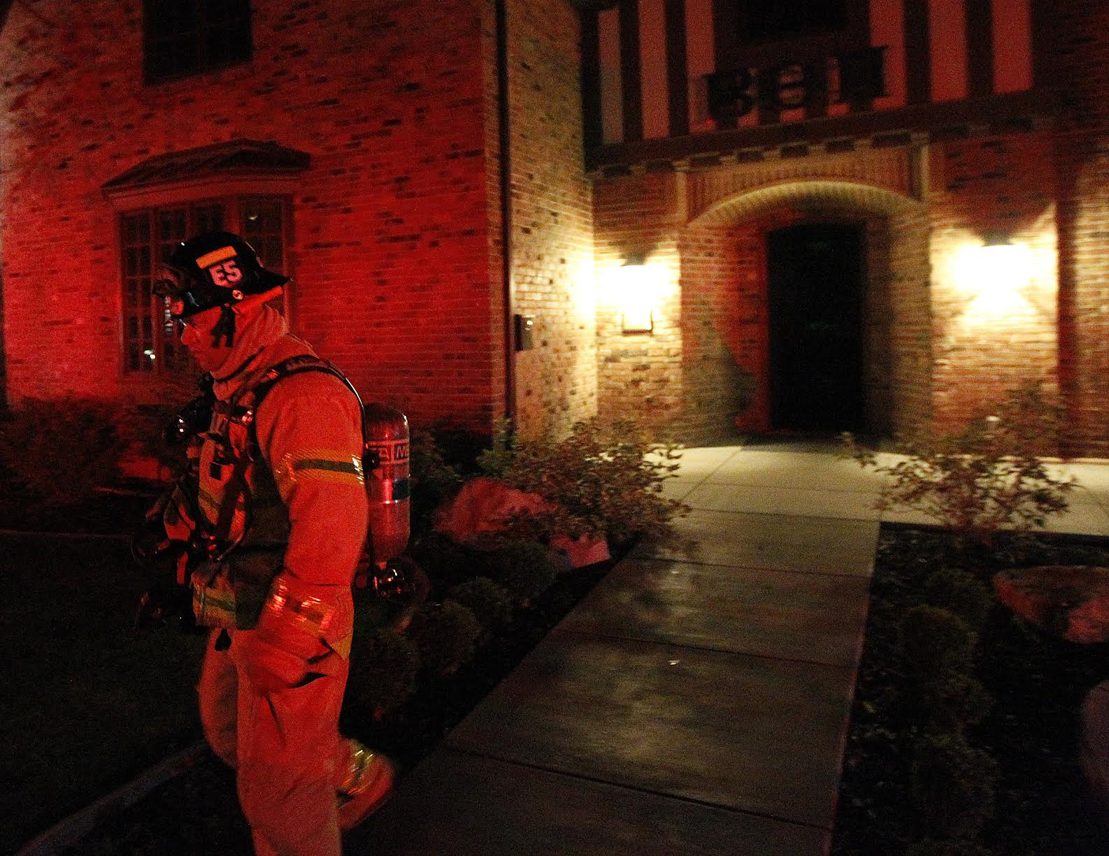 Fire crews respond to a call at the Beta Theta Pi fraternity house at the University of Utah, Friday, July 3, 2015. Fires were reported at two fraternity houses early morning Friday.