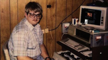 a nerdy dude on the computer